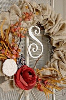Burlap wreath, (note to self: I have the burlap and the fall stems I bought for pennies at a yard sale) Would make a cute rustic Christmas wreath with pinecones & red berry sprigs or holly leaves.