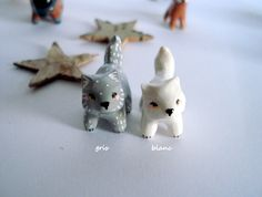 Amulet My Little wolf (white or grey) oMamaWolf -miniature handmade sculpture in polymer clay- lucky charm by oMamaWolf on Etsy https://www.etsy.com/listing/254579043/amulet-my-little-wolf-white-or-grey