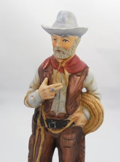 """Cowboy and Lasso Figurine 7 5/8"""", Vintage Ceramic Cowboy Figurine, Cowboy with Pistol and Lasso Wearing Chaps, 1970s Collectible Figurine by ShellyisVintage on Etsy"""