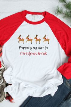 """This fun, cute Christmas raglan is perfect for wearing the week before winter break! """"Prancing my way to Christmas break"""" is the perfect teacher tee this December! And, it's not teacher specific so it can be worn by administrators, instructional assistants, paraprofessionals, and other school staff."""