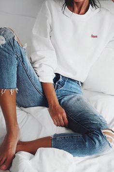 Ripped jeans and a simple sweatshirt.
