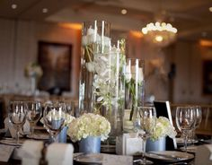 submerged orchid and hydrangea arrangements | cylinders filled with submerged white flowers such as tulips, orchids ...