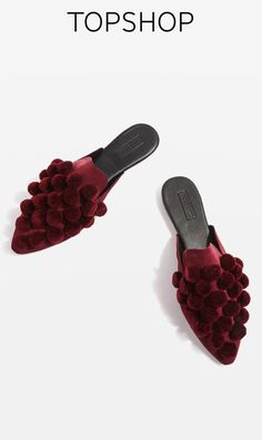 These Bordeaux red mules come festooned with fun pompom appliques and an elegant pointed toe. Effortless to slip into, this flat style is a new season essential.