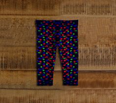 Christmas Lights Kids Leggings  Artwork in baby friendly sizes on our printed leggings for your little ones. Made with our signature knit fabric, milled in Montreal. Super stretchy for easy movement. Made to last, our fabric won't lose shape and our vibrant prints never fade.