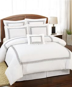Indulge in all the luxury a five-star hotel right at home with this sophisticated embroidered bedding set. Crisp, clean lines create a marvelously modern vibe, while the oversize, overfilled design ensures opulently plush comfort.