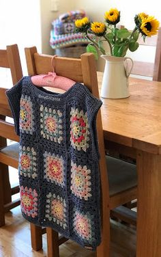 And here it is all finished last Friday, just in time for a heat wave! Seriously I do love this jumper and it fits so well with a white t sh. Gilet Crochet, Crochet Jumper, Crochet Coat, Crochet Cardigan Pattern, Granny Square Crochet Pattern, Crochet Jacket, Crochet Flower Patterns, Crochet Squares, Crochet Granny