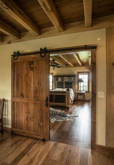 12 Awesome Bedroom Barn Door Ideas Oak bedroom barn door The decoration of our home is a lot like a. Bedroom Barn Door, Oak Bedroom, Barn Bedrooms, Huge Master Bedroom, Master Suite, Master Bath, Bedroom Ideas, Barn Door Designs, Timber Frame Homes
