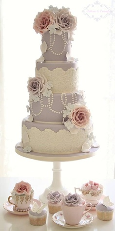 Lavender and rose wedding cake. Very vintage and romantic, and we love the tea cups at the bottom