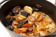 Free image of Hot pot stew in a casserole dish Black Pudding, Hot Pot, Pot Roast, Casserole Dishes, Stew, Lamb, Potatoes, High Angle, Cooking