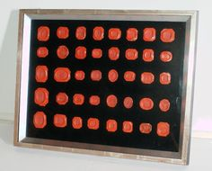 179: Collection of 40 antique red wax seals, framed. : Lot 179