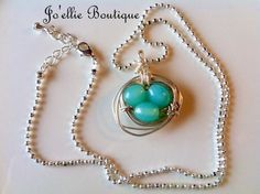 robins egg blue nest necklace wire wrapped by joellieboutique.etsy.com $23.00 hand wire wrapped nest on sterling ball chain bird nest wedding theme