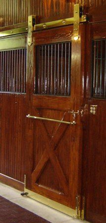 Oh my goodness, these are beautiful horse stalls. Love the brass!