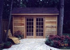 #backyard #shed turned into living space: framed stone walkway, wooden lounge chair, french doors, reclaimed wood