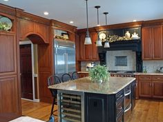 love the dark cabinets with the lighter floor