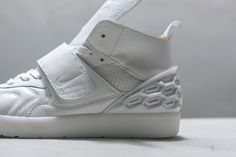 This football-inspired lifestyle sneaker from NikeLab is seen in two new makeups.