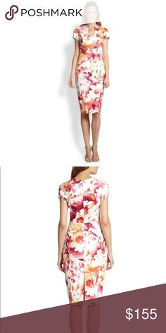 """Black Halo - Gypsy Rose Floral Dress - Sz 8 A polished, chic silhouette, patterned with a colorful floral print and finished with a sculptural hem. Cutout neckline. Short sleeves. Impeccably  seamed for a svelte silhouette, a sheath dress is opened by a curving split neckline that eases the hourglass form. 42"""" length (size 8). Hidden back-zip closure. Fully lined, with shoulder pads. 97% polyester, 3% spandex. Dry clean. By Black Halo; made in the USA. Dresses. Black Halo Dresses Midi"""