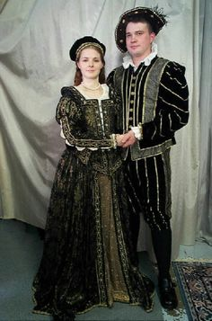 This stunning Elizabethan gown is of gold and black brocade, with yards of embroidered trim and sewn with freshwater pearls and garnets. The...