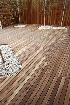 Cutting holes in deck to plant trees for Deck Landscaping with white rocks as fill. Deck Landscaping, Landscaping With Rocks, Timber Deck, Garden Architecture, Wooden Decks, Wooden Slats, Garden Inspiration, Outdoor Gardens, Garden Design