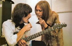 sirpeter64:  George Harrison and Pattie Boyd in the recording studio. Don't know of another shot of then together in this sort of location. Rescan.   I always imagine Pattie's just come by the studio to see George because she's left him. She is furious about his affair with Charlotte Martin, but she's still worried about him. And he feels terribly guilty and will soon beg Pattie to come home.