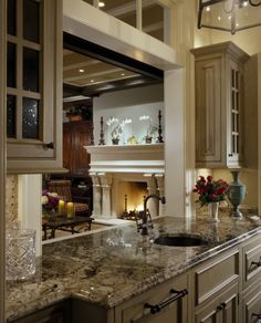 have an open area/window that looks into the living room from the kitchen.