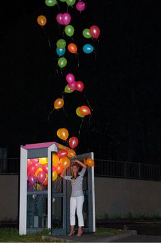 For his urban intervention titled Ballooth, German street artist ich bin KONG (previously) loaded random phone booths with dozens of helium-filled balloons in Wiesbaden.