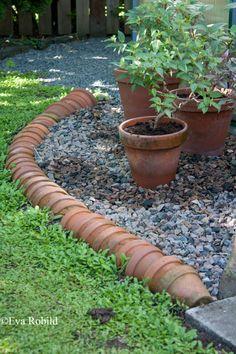 Garden pots made into a border - upcycle garden idea