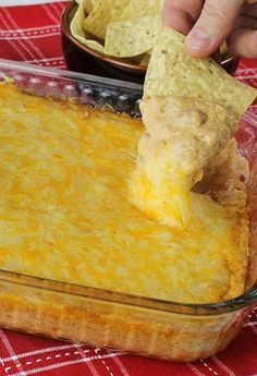 Texas Trash Dip (cream cheese, sour cream, taco seasoning, green chilies, 2 cans refried beans & 3 cups of shredded cheeses)