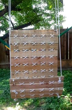 Outdoor hanging chair swing made from pallets
