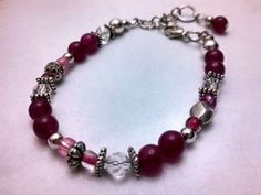 Shades  of pinks and crystal glass beads in various sizes with metal spacers.  Adjustable clasps $15.