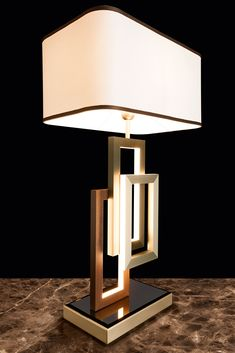 Reverberating light from its fluid lines, creating a display of brilliance and shadows... discover the fabulous Modern Italian Geometric Designer Table Lamp With Shade at Juliettes Interiors ✨