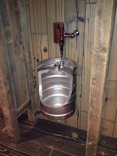 UPCYCLED KEG???Man bathroom. Would be so awesome for a shop or something haha.