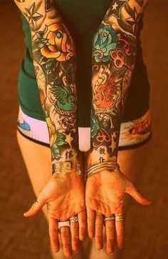 Beautiful coloured sleeve tattoos