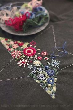 Make a running stitch border for shapes, fill in with embroidery,