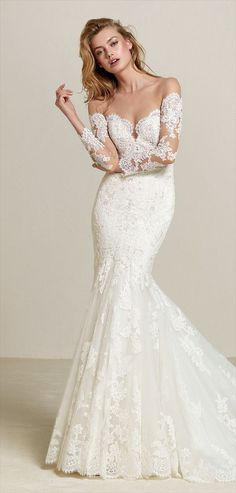 Pronovias 2018 mermaid wedding dress in lace and thread embroidery - Femininity and sensuality are the essence of this mermaid dress in tulle, lace and thread embroidery and gemstone appliqués. A large train design with an illusion off-the-shoulder neckline with French sleeves. Undoubtedly, a design that will have all eyes on you.