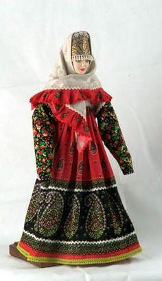 A doll in the festive costume from Vologda Province, Russia. Fashion of the 19-th century.