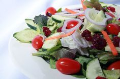 Garden Salad ~ Mixed Greens with Crisp Cucumbers, Tomatoes, Dried Cranberries. Served with Italian and House Dressing on the side