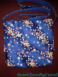 """Cherry Blossom Cross Body Bag. Approx. 11.5 """" height X 11"""" width. Strap measures approx. 53"""". With 2 interior pocket."""