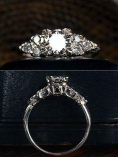 1940s Late Deco 0.65ct Brilliant Cut Diamond (E-F SI1) Ring ~0.30ctw Brilliant Cut Diamond Sides, Platinum