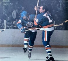 BAM! Islander shorthanded specialists Ed Westfall and Lorne Henning in a mid-ice collision, ca. 1977-78.
