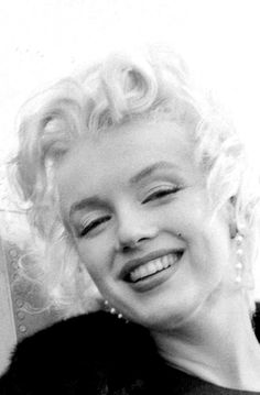 Marilyn disembarking from a plane in Los Angeles to film Bus Stop, February 1956. Photo by Milton Greene.
