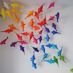 These koi fish by origami artist Sipho Mabona have lots of decorative possibilities. In the photo, several different colors of the koi are suspended from wires to give them the appearance of swimming … Origami Koi Fish, Origami Insects, Rainbow Origami, Rainbow Paper, Lotus Origami, Origami Birds, Origami Cranes, Origami Animals, Kirigami