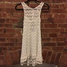 FREE PEOPLE white lace dress Free people New Romantics Dress. See through with lace designs. Should be worn with slip...or not. Up to you ;p Great condition. Free People Dresses Mini