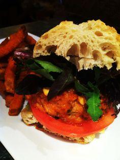 salmon burger on ciabatta and seasoned sweet potato fries.