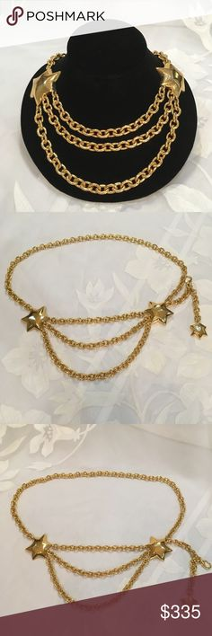 🎉HP🎉 Vtg. 90's Valentino Chain Belt or Necklace Vintage 90's Valentino gold tone chain belt or necklace with stars. Measures 41 inches long and has a hook closure and lobster claw closure for a dangling star. The center stars and chain measures 10 1/2 inches long with a 4 inch drop. In excellent preowned condition. Solid weight. Made in the USA. Vintage Jewelry Necklaces