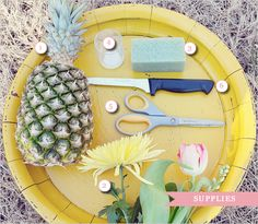 Supplies: 1. Assorted large fruits and/or vegetables 2. Variety of flowers 3. Floral foam 4. Votive holder 5. Scissors 6. Knife