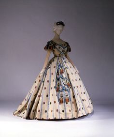 I like her sash... a fun way to change up your ball gown after a season or two.    Ball Gown, 1861–62, American