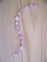 Breast Cancer ribbon bracelet.  $25.00  Show your support with this beautiful Piece!