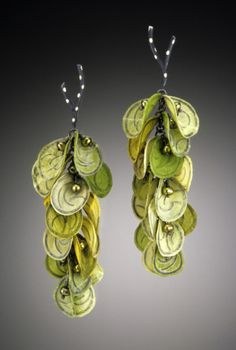 Earrings   Carol Windsor. Carol's technique laminates sterling silver between 2 to 5 layers of acid free paper.