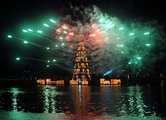 Fireworks explode around a giant Christmas tree during the lighting ceremony at Rodrigo de Freitas Lake in Rio de Janeiro