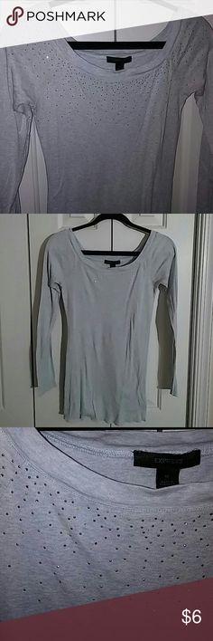 Express Sparkle long-sleeve tee Express Sparkle long sleeve tee has plenty of length in the torso and sure to turn heads. The front sparkles from all directions and it's super soft with a beautiful baby blue-white wash color. There are approximately 20 of the little sparkles that fell off as you can see in picture 3 what that looks like with one of them off, but there are so many sparkles the missing ones are significantly unnoticeable. Express Tops Tees - Long Sleeve